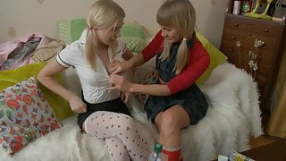 Naughty blonde schoolgirls fill each other's holes with toys